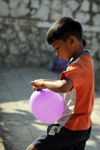 Boy Blowing Balloons - Public Domain Pictures