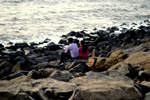 4151-couple-sitting-rocks-sea - Public Domain Pictures