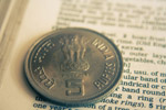 Coin On Dictionary - Public Domain Pictures