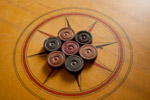 Carrom Coins In Center - Public Domain Pictures