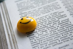 Yellow Smiley On Book - Public Domain Pictures