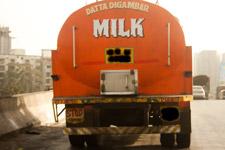 Milk Van On Road - Public Domain Pictures