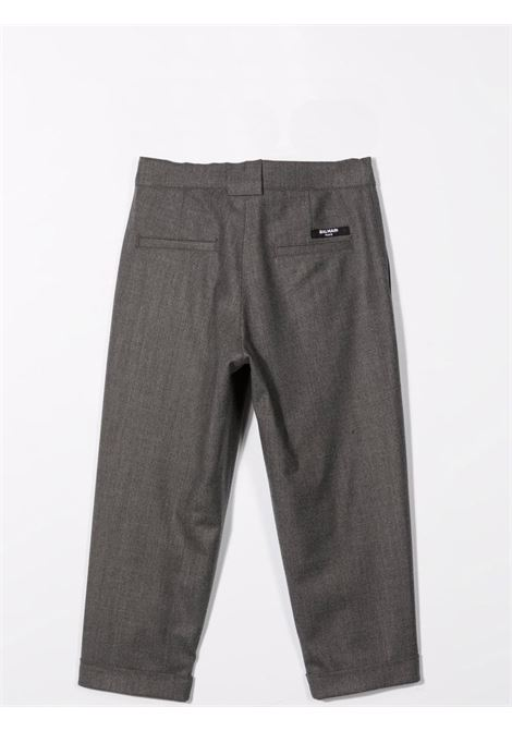 Gray trousers with front closure BALMAIN KIDS | 6P6550 I0008912