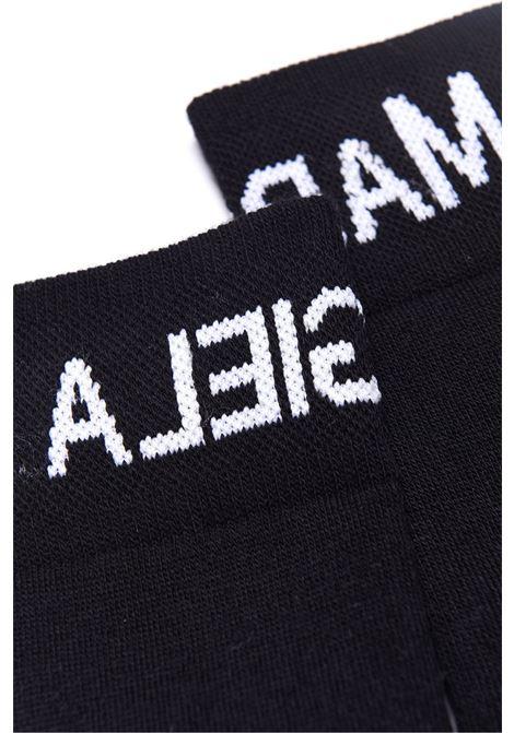 Black socks with print MM6 KIDS MAISON MARGIELA | M60071 MM031M6900