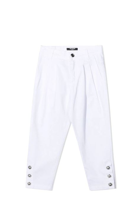 TROUSERS WITH APPLICATION BALMAIN KIDS | Trousers | 6O6190 OC120100AG