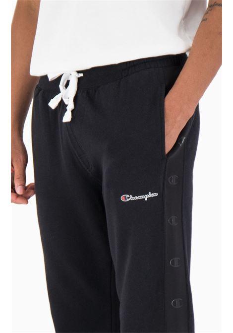JOGGERS FELPATI CON BANDA C LOGO CHAMPION | Pantalone Tuta | 214787KK001