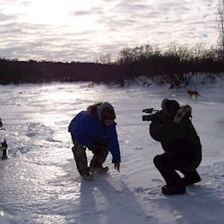 Ten seconds later he fell through the ice!  Everybody was OK, but WHEW!