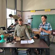 Preparing a shot in a classroom with actors.