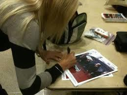 Jennifer Barbaro autographing posters after winning Best Director