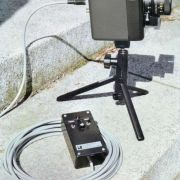 """""""CCTV Surveillance Camera"""" featuring cabled remote control of focus, zoom, & tally light functions."""