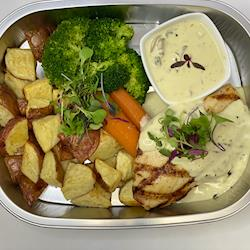 Grilled Chicken with a citrus beurre blanc, roasted potatoes and steam brocolli and carrots