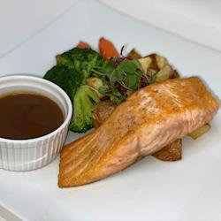 Grilled Salmon Filet with a citrus beurre blanc, roasted red potatoes and steamed brocolli and carrots