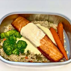 Grilled Salmon Filet with a citrus beurre blanc, wild rice and steamed brocolli and carrots
