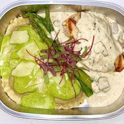 Grilled Chicken with a mushroom cream sauce and Portobello Mushroom Ravioli with a pesto sauce (*vegetarian)