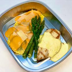 Grilled Chicken with a citrus beurre blanc and Portobello Mushroom Ravioli with a sundried tomato cream sauce
