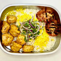 Mangal-grilled chicken kebab, basmati rice with saffron and grilled tomato