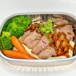 Beef Brisket with carmelized onions, mashed potatoes and steamed brocolli and carrots