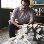 Narcos scene with prop movie money stacks.