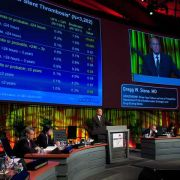 Wide shot auditorium, big data screens