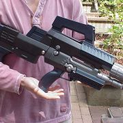 """""""Tyr's Over-Under Assault Rifle"""" from the TV series ANDROMEDA. Featured a removable magazine, sequenced LED indicators and a multimode squib firing circuit. (Primary Fabrication: Bob Boel & Charlie Gr"""
