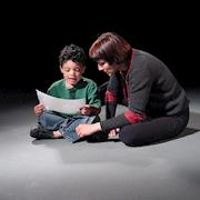 Producer Angela Gamburg directs a child actor.