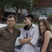 """Director Chris Chandler with lead actor and actress, James Richter and Jackie Shea on the set of """"Life's A Pitch""""."""