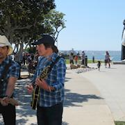 """Brad Paisley and John Fogerty Perform Their Music Video """"Love and War"""" in San Diego"""