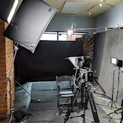 2 camera black backdrop interview setup with teleprompter