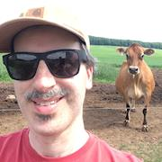 Spooner WI.  Freelancing as B Roll Camera.  Photobombing Cow!