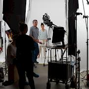 Marketing video being shot in an all-white studio set.