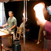 Lighting a scene for a corporate promotional video.