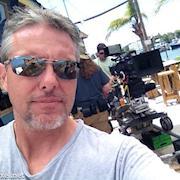 DIT mark on the scene prepping cam for next scene