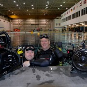 Jonathan Bird and Tim Geers at the Neutral Buoyancy Lab at the Johnson Space Center, Houston, TX, where astronauts are trained for space walks.