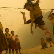Children play without wearing any protection from the haze.