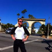 """Director Wynn Ponder in his best """"we have arrived"""" pose before driving on into Paramount Picture studios to record Lita Ford's narration for the film."""