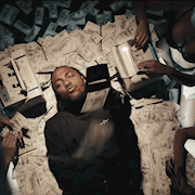 """Kendrick Lamar laying down on our prop money for his """"Humble"""" music video."""