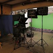 Our small studio with a green-screen setup.