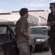 """Screen shot of Jimmy having a run in with a cop. """"Life's A Pitch"""""""