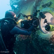 Jonathan filming through the view port at Aquarius Reef Base, Key Largo, Florida, as part of a giant screen (fulldome) film about astronaut training.