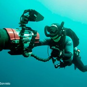 Jonathan Bird filming sea snakes in Indonesia.