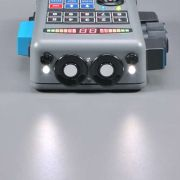Front of the unit features simulated sensors and a user-activated white-light illuminator...