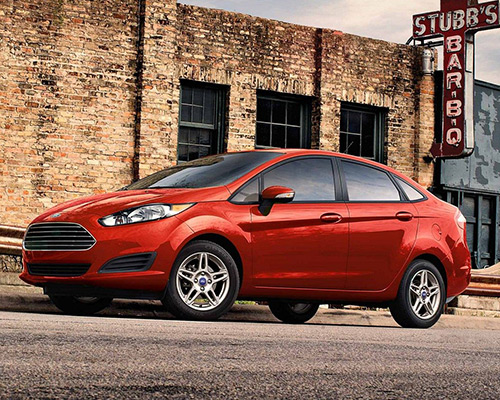 Red Ford Fiesta SE waiting for you here at Bill Dube Ford in Dover.