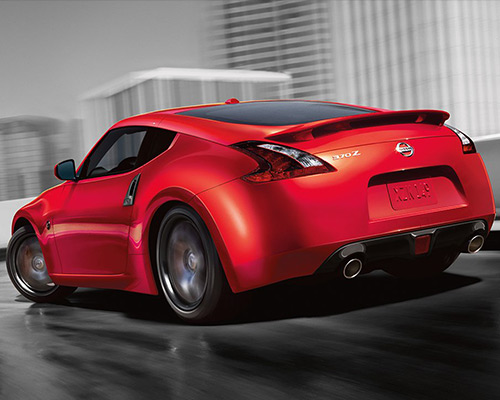 Red Nissan 370Z Sport for sale or lease at Universal Nissan in Orlando.