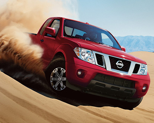 Red Nissan Frontier Desert Runner for sale or lease here at Universal Nissan in Orlando FL.