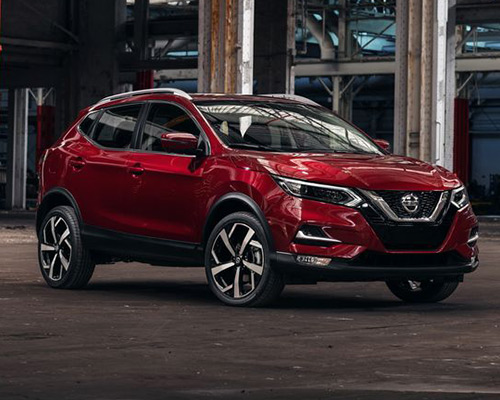 Red Nissan Rogue Sport S for sale or lease at Universal Nissan in Orlando.