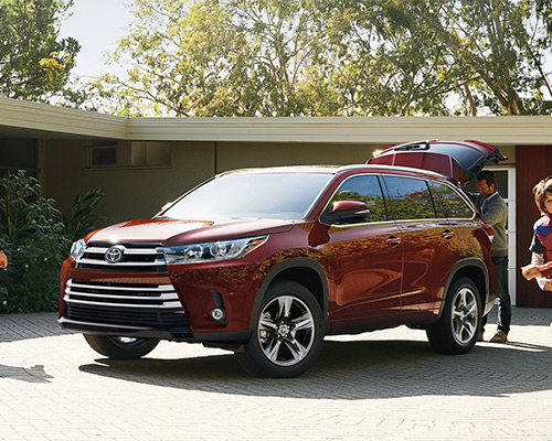 Maroon Toyota Highlander LE for sale or lease in Grand Rapids at Toyota of Grand Rapids.