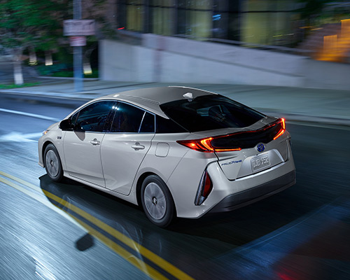 White Toyota Prius Prime Plus available at Bill Dube Toyota in Dover.