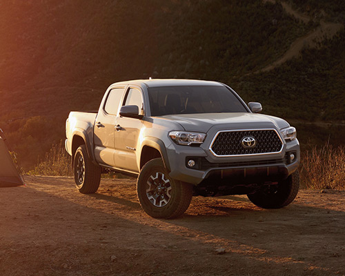 White Toyota Tacoma SR5 for sale or lease at Westbury Toyota in Westbury.