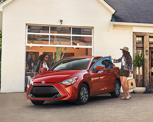 Red Toyota Yaris LE for sale or lease at Toyota of Grand Rapids in Grand Rapids.