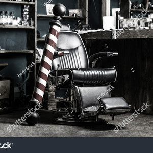 Stock photo logo of the barbershop symbol stylish vintage barber chair hairstylist in barbershop interior 1137184640